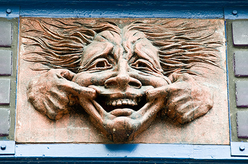 Bas relief of Joker making a face at the viewer, from the facade of the old Jubilee Theatre at 235 Main Street, Vancouver, BC